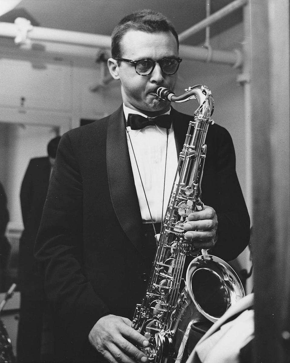 """<p>Tenor sax player Stan Getz popularized bossa nova jazz with his worldwide hit """"The Girl from Ipanema."""" Getz's musical style was smooth and heavily influenced by Brazilian music, giving his work its characteristically sexy sound. Usually dressed formally, in his later years Getz wore some pretty cool printed shirts that also seemed to be influenced by his love for South American culture. <i>(Photo: Getty Images)</i></p>"""