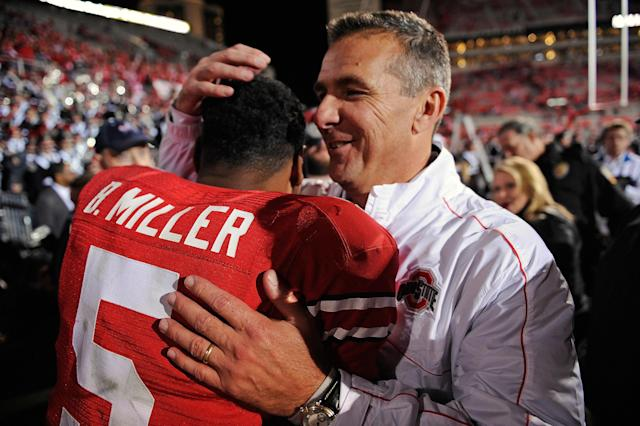 COLUMBUS, OH - OCTOBER 6: Head Coach Urban Meyer hugs quarterback Braxton Miller #5 of the Ohio State Buckeyes after the Buckeyes defeated the Nebraska Cornhuskers 63-38 at Ohio Stadium on October 6, 2012 in Columbus, Ohio. (Photo by Jamie Sabau/Getty Images)