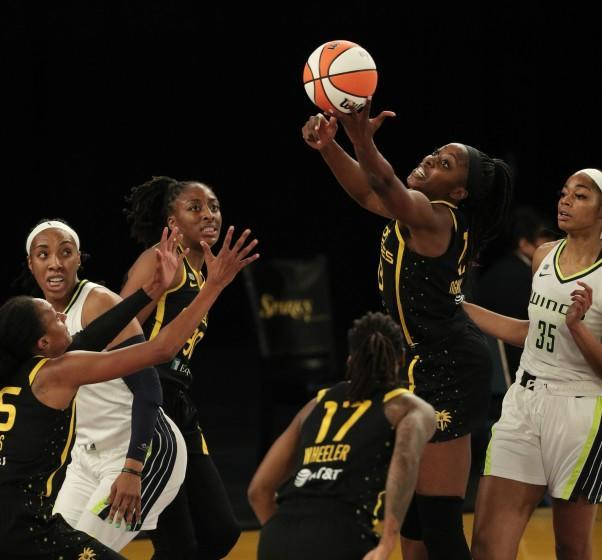 The Sparks' Chiney Ogwumike grabs a defensive rebound in front of the Dallas Wings' Charli Collier on May 14, 2021.