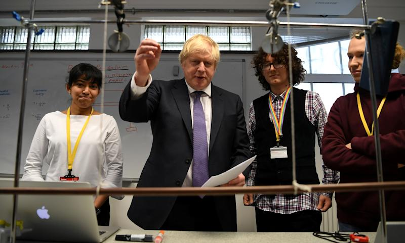 Britain's Prime Minister Boris Johnson reacts as he listens to students during his visit to King's Maths School, part of King's College London University, in central London, Britain January 27, 2020. Daniel Leal-Olivas/Pool via REUTERS
