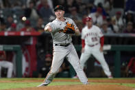 San Francisco Giants starting pitcher Anthony DeSclafani throws out Los Angeles Angels' Max Stassi at first base after a ground ball during the seventh inning of a baseball game Tuesday, June 22, 2021, in Anaheim, Calif. (AP Photo/Marcio Jose Sanchez)