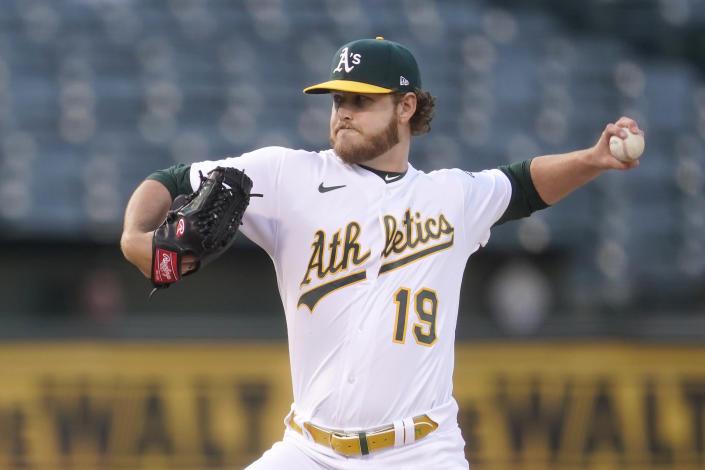 Oakland Athletics' Cole Irvin (19) pitches against the Toronto Blue Jays during the first inning of a baseball game in Oakland, Calif., Tuesday, May 4, 2021. (AP Photo/Jeff Chiu)