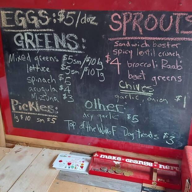Acadian Acres Farm and Wild Edibles in Sampsonville has set up this roadside farmstand where customers can come and pick up fresh produce and other items.