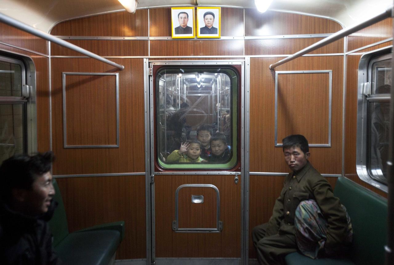 In this March 10, 2011 photo, children look through a subway car window in Pyongyang, North Korea. (AP Photo/David Guttenfelder)