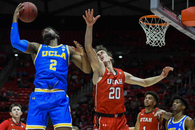 UCLA forward Cody Riley (2) grabs a rebound over Utah forward Mikael Jantunen (20) during the first half of an NCAA college basketball game Thursday, Feb. 20, 2020, in Salt Lake City. (AP Photo/Alex Goodlett)