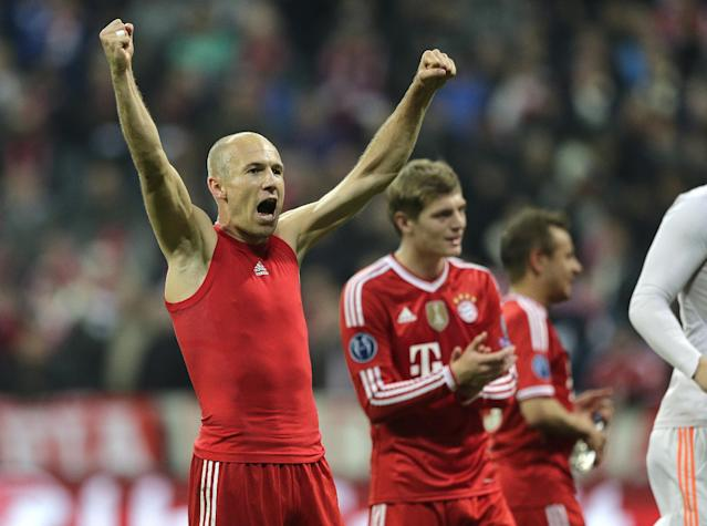 Bayern's Arjen Robben celebrates at the end of the Champions League quarterfinal second leg soccer match between Bayern Munich and Manchester United in the Allianz Arena in Munich, Germany, Wednesday, April 9, 2014. Bayern won 3-1 to win the tie 4-2 on aggregate. (AP Photo/Matthias Schrader)
