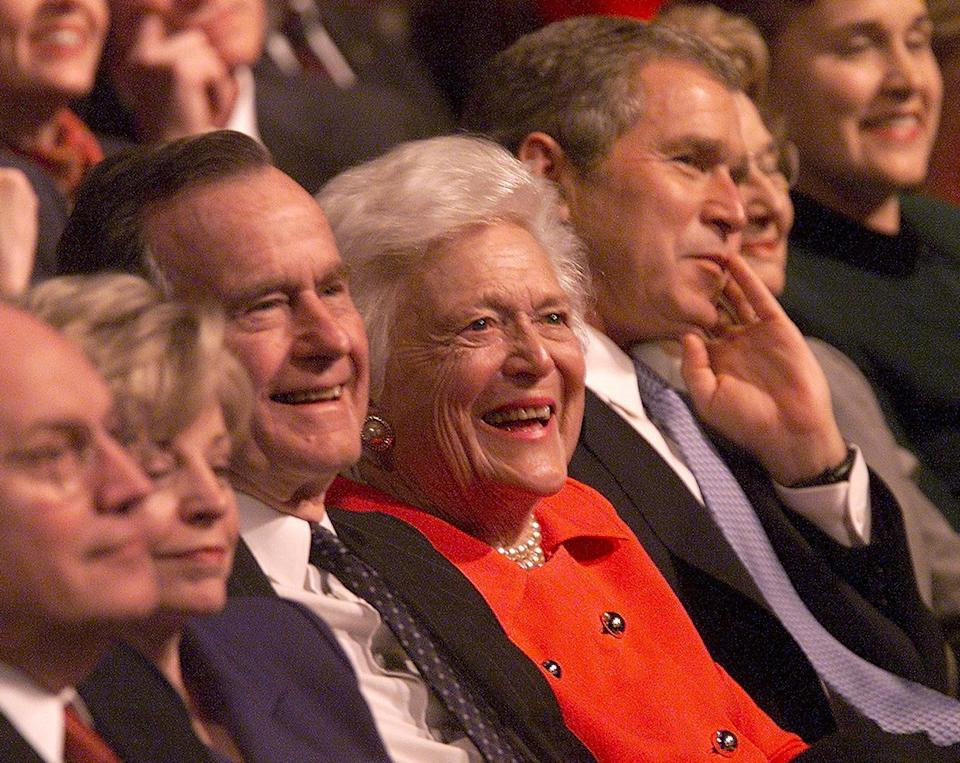 President-elect George W. Bush (right) sits in the audience with (from left) Vice President-elect Dick Cheney, Lynne Cheney, George H.W. Bush and Barbara Bush during the Laura Bush Celebrates America's Authors program on Jan. 19, 2001, in Washington, D.C.