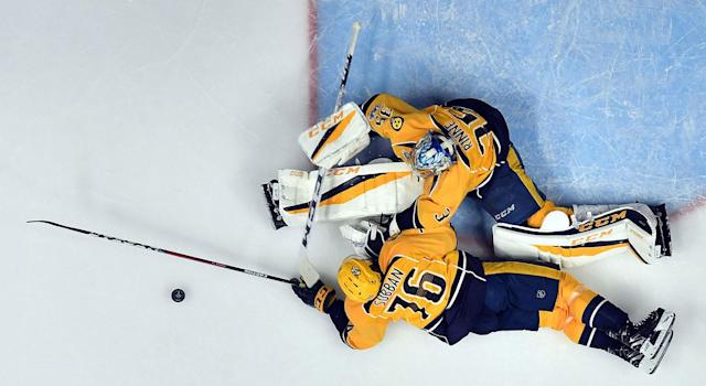 <p>Pekka Rinne came up with a number of big stops for the Predators, none bigger than this sprawling save in the second period. (Christopher Hanewinckel-USA TODAY Sports) </p>