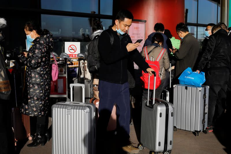 Travellers arrive at Beijing Capital International Airport