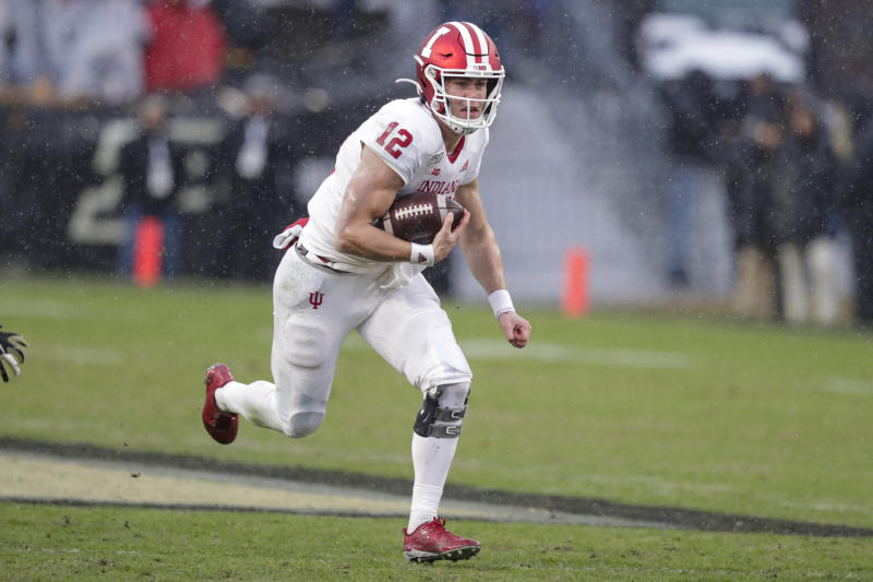 Indiana quarterback Peyton Ramsey (12) runs against Purdue during the first half of an NCAA college football game in West Lafayette, Ind., Saturday, Nov. 30, 2019. (AP Photo/Michael Conroy)