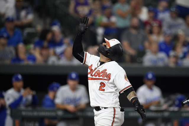 Baltimore Orioles' Jonathan Villar celebrates his three-run home run during the seventh inning of the team's baseball game against the Los Angeles Dodgers, Wednesday, Sept. 11, 2019, in Baltimore. Villar connected for the 6,106th homer in the majors this season. That topped the mark of 6,105 set in 2017. The Orioles won 7-3. (AP Photo/Nick Wass)