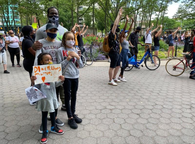 Boatwright and family attend a memorial in Brooklyn's Cadman Plaza Park for George Floyd