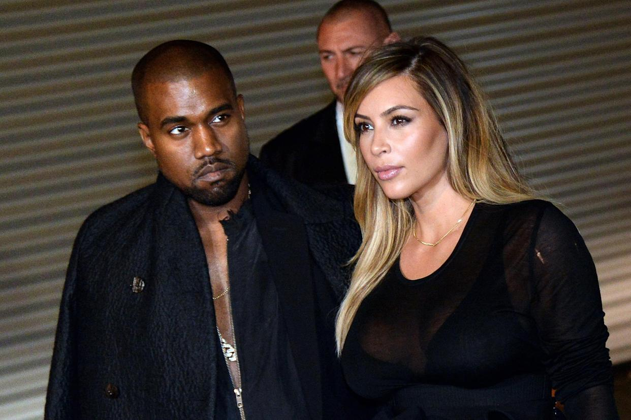 US musician Kanye West and partner Kim Kardashian pose prior to Givenchy 2014 Spring/Summer ready-to-wear collection fashion show, on September 29, 2013 in Paris.   AFP PHOTO / PIERRE ANDRIEU        (Photo credit should read PIERRE ANDRIEU/AFP/Getty Images)