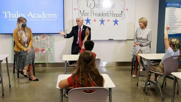 PHOTO: Vice President Mike Pence and Education Secretary Betsy DeVos visit with teacher Allison Combs, left, and her fourth grade students at Thales Academy which reopened to students in Apex, N.C., July 29, 2020. (Gerry Broome/AP)