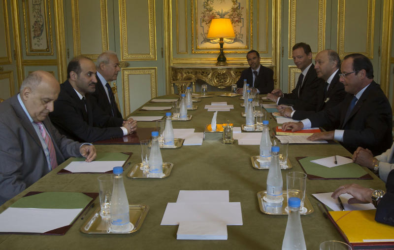 Head of the Syrian National Coalition, Ahmad al-Jarba, second from left, meets France's President Francois Hollande, right, at the Elysee Palace Thursday Aug. 29, 2013. (AP Photo/Michel Euler, Pool)