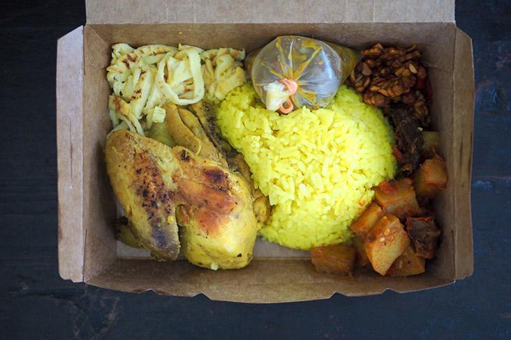 'Nasi kuning' can be eaten in the paper box and is available on FoodPanda and Grab Food