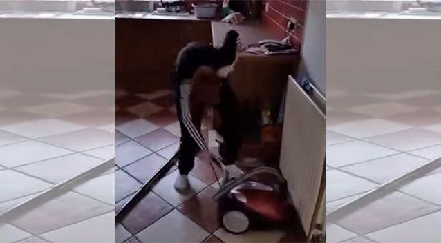 An Irish dad humours his young son who can't figure out how to start a vacuum cleaner. Source: YouTube/Meanwhile in Ireland