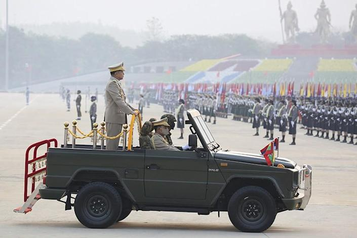 Myanmar's military chief, Senior Gen. Min Aung Hlaing, reviews troops during Armed Forces Day on Saturday.