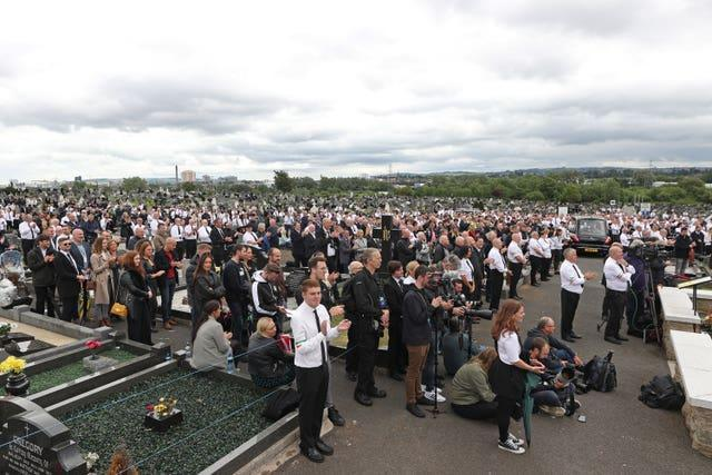 A crowd at the funeral