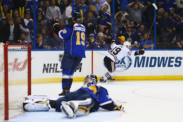 ST. LOUIS, MO - APRIL 25: Jonathan Toews #19 of the Chicago Blackhawks celebrates after scoring the game-winning goal against the St. Louis Blues in Game Five of the First Round of the 2014 Stanley Cup Playoffs at the Scottrade Center on April 25, 2014 in St. Louis, Missouri. The Blackhawks beat the Blues 3-2 in overtime. (Photo by Dilip Vishwanat/Getty Images)