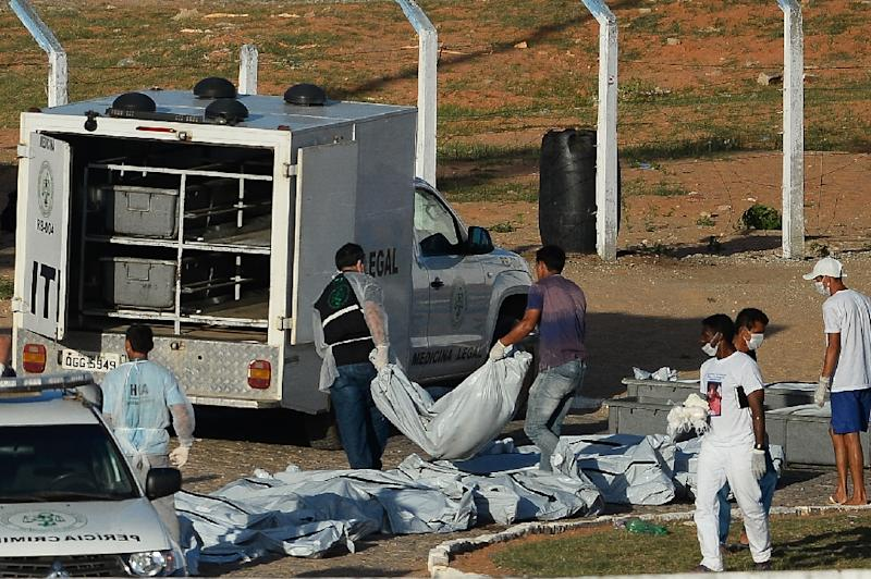 Corpses are removed from the Alcacuz Penitentiary after a fight between rival gangs left at least 26 prisoners dead, near Natal, in Brazil's state of Rio Grande do Norte, on January 15, 2017