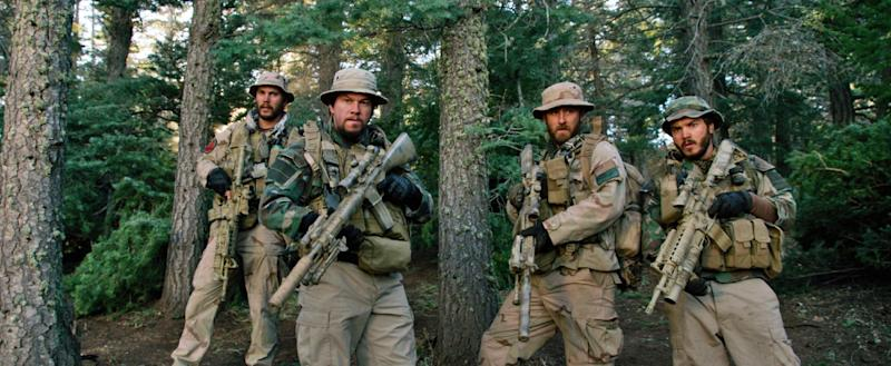 """This photo released by Universal Pictures shows, from left, Taylor Kitsch, as Michael Murphy, Mark Wahlberg as Marcus Luttrell, Ben Foster as Matt """"Axe"""" Axelson, and Emile Hirsch as Danny Dietz in a scene from the film, """"Lone Survivor."""" """"Frozen's"""" grip on the domestic box office is heading for a meltdown as the combat docudrama """"Lone Survivor"""" threatens a firefight for the top spot with an expected gross of $15 million. (AP Photo/Universal Pictures)"""