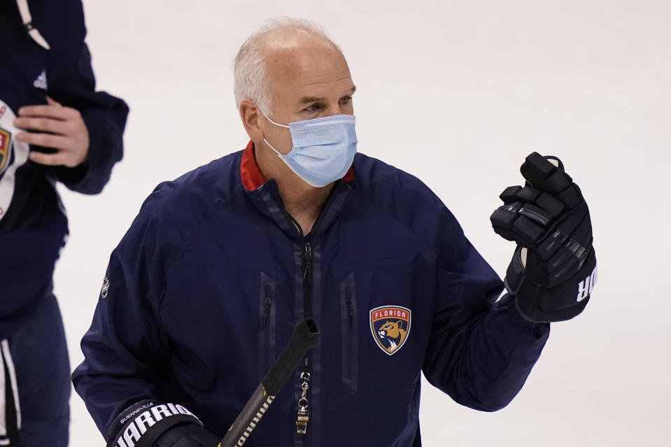 FILE - Florida Panthers head coach Joel Quenneville talks with the team during NHL hockey training camp in Sunrise, Fla., in this Wednesday, Jan. 6, 2021, file photo. Year 2 of the Joel Quenneville coaching era Florida has the Panthers looking very much like a Stanley Cup contender. At the midpoint of this season, the Panthers are 19-5-4, tied for the most points in the NHL entering Tuesday and off to the best 28-game start in their history. (AP Photo/Lynne Sladky, File)