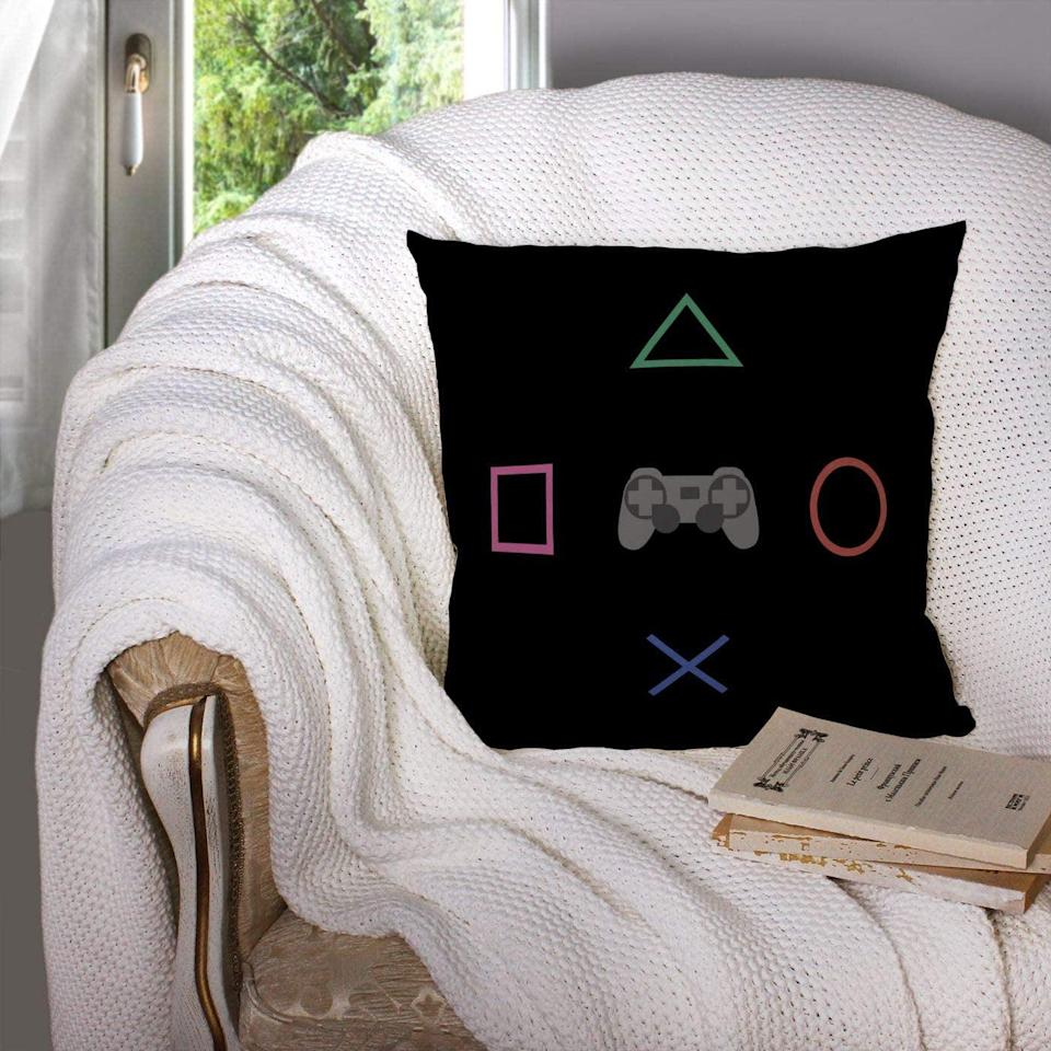 <p>Help them rep their love of gaming with this <span>Couch Pillow Case</span> ($10).</p>