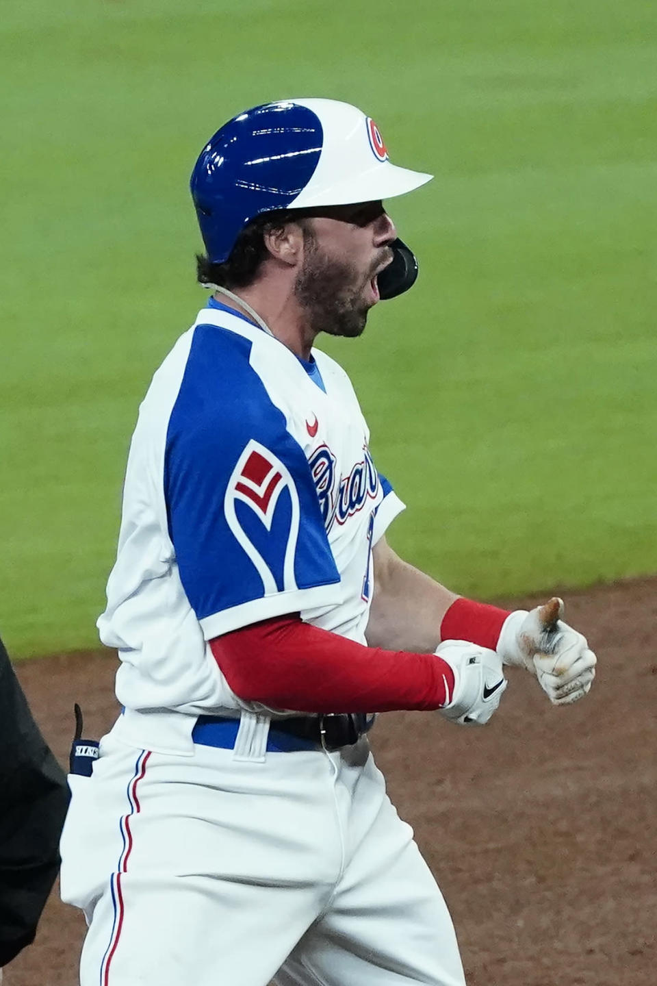 Atlanta Braves' Dansby Swanson (7) reacts after driving in a run with a double In the sixth inning of a baseball game against the Philadelphia Phillies, Saturday, April 10, 2021, in Atlanta. (AP Photo/John Bazemore)