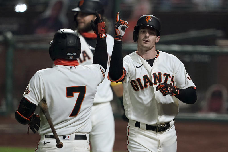 San Francisco Giants' Mike Yastrzemski, right, gestures with teammate Donovan Solano (7) after hitting a three-run home run against the Seattle Mariners during the third inning of a baseball game Wednesday, Sept. 9, 2020, in San Francisco. (AP Photo/Tony Avelar)