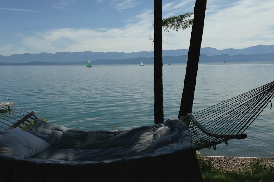 """<h2>Flathead Lake, Montana</h2><br><strong>Location</strong>: Lakeside, Montana<br><strong>Sleeps</strong>: 2<br><strong>Price Per Night</strong>: $349<br><br>""""Enjoy incredible Flathead Lake and mountain views, including Glacier National Park from the suite. The suite accommodates 2 guests only and sits 20 feet from the private beach. The West Entrance of Glacier National Park is one hour away.""""<br><br><h3>Book <a href=""""https://airbnb.pvxt.net/BXnDe9"""" rel=""""nofollow noopener"""" target=""""_blank"""" data-ylk=""""slk:Flathead Lakefront Suite For Two"""" class=""""link rapid-noclick-resp"""">Flathead Lakefront Suite For Two</a></h3>"""