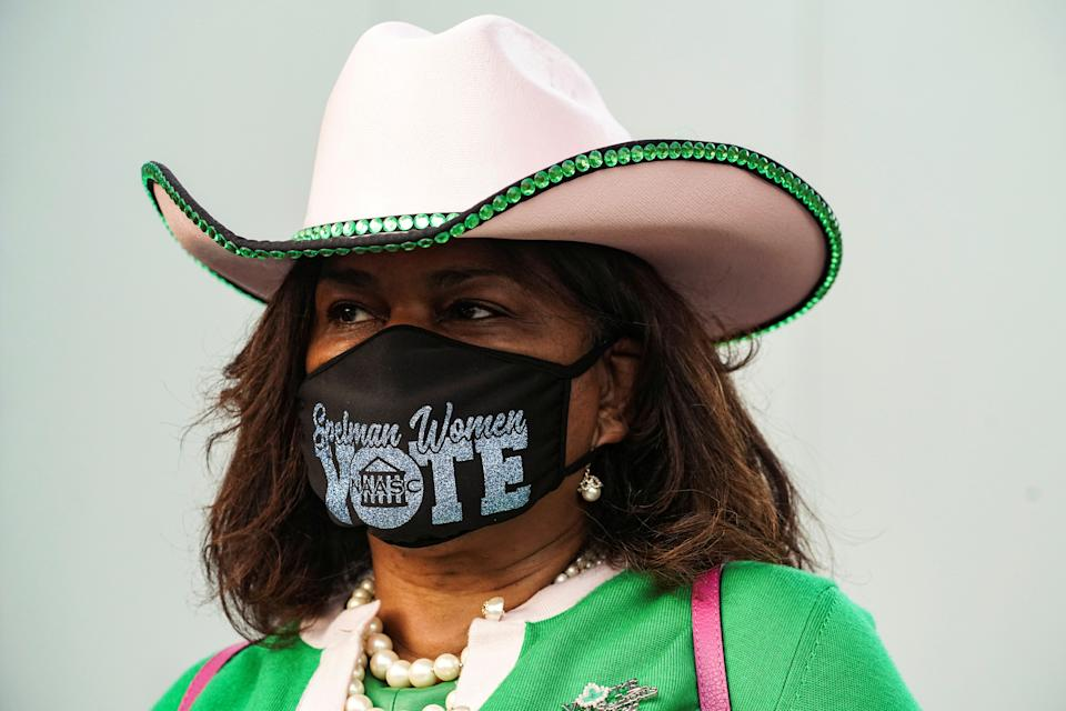 Deirdre Barrett wears a protective mask as she waits in line to cast her ballot for the upcoming presidential election as early voting begins in Houston, Texas, U.S., October 13, 2020.  REUTERS/Go Nakamura     TPX IMAGES OF THE DAY