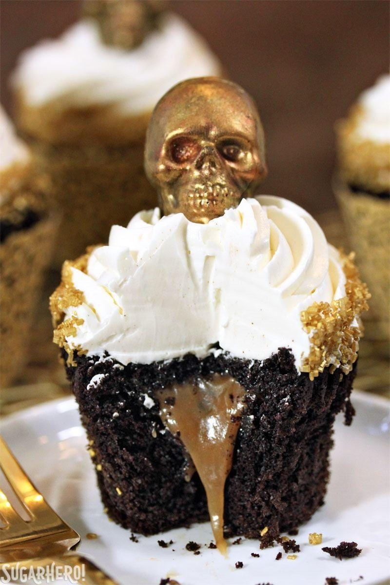 "<p>Top them with homemade gold caramel skulls for a fancy AF Halloween celebration.</p><p>Get the recipe from <a href=""http://www.sugarhero.com/caramel-stuffed-chocolate-cupcakes/"" rel=""nofollow noopener"" target=""_blank"" data-ylk=""slk:SugarHero!"" class=""link rapid-noclick-resp"">SugarHero!</a>.</p>"