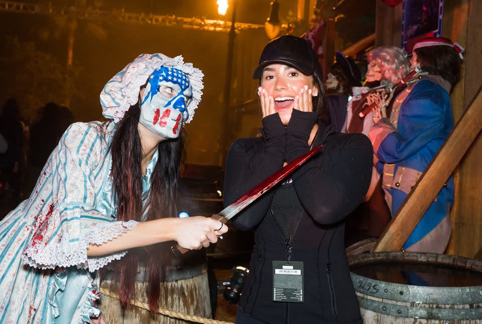 <p>We're not sure what Demi is dressed as for this Halloween party, but her dewy skin and soft brows are goals. (Photo: Courtesy of Halloween Horror Nights/Facebook)</p>