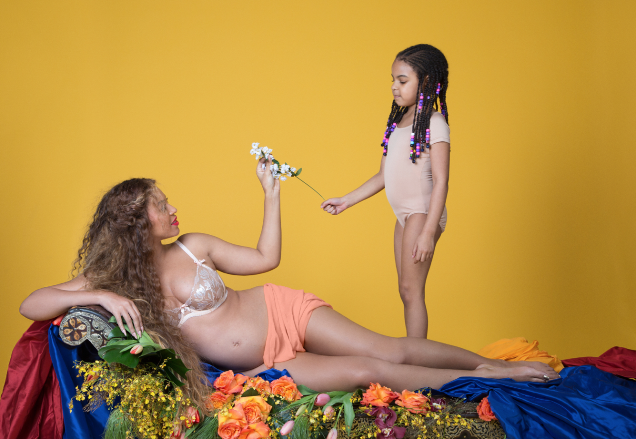 <p>It's unclear whether Beyoncé is handing the rose to Blue or the other way around, but what is clear is that her firstborn is fully on-board with the photoshoot. (Photo: Beyonce.com) </p>