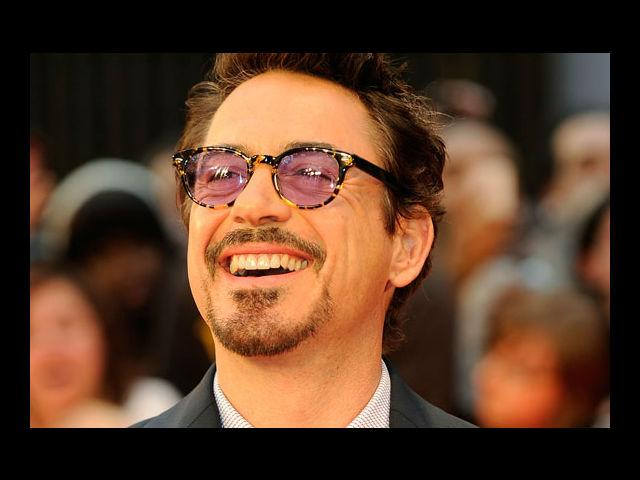 <b>1) Robert Downey Jr</b><br> There is absolutely nothing better than a man who can both rock his suit and his moustache at the same time. Add that charismatic smile and we simply melt!