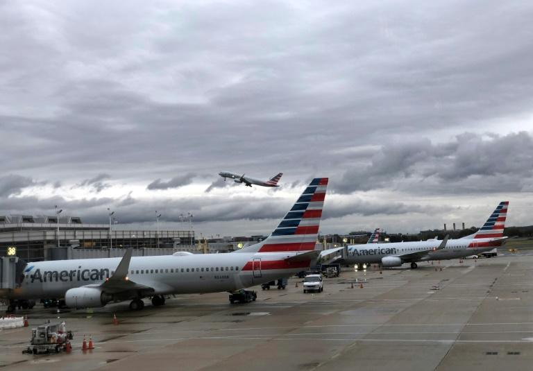 American Airlines reported a jump in fourth-quarter profits on continued strong consumer demand that offset the hit from the 737 MAX grounding (AFP Photo/Daniel SLIM)