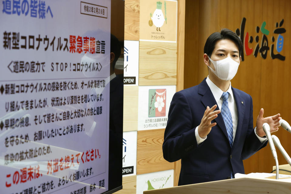 Hokkaido Gov. Naomichi Suzuki speaks at a press conference at the Hokkaido Government in Sapporo, northern Japan Friday, Feb. 28, 2020. The Japanese island of Hokkaido is declaring a state of emergency over the rapid spread of the new virus there. (Yohei Fukai/Kyodo News via AP)