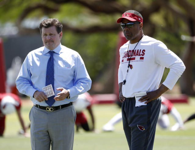 Arizona Cardinals NFL football team president Michael Bidwill, left, and head coach Steve Wilks watch their team run drills during a voluntary team activity Tuesday, April 17, 2018, at the Cardinals' training facility in Tempe, Ariz.(AP Photo/Matt York)