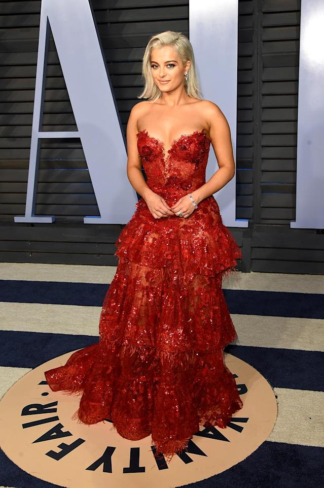 <p>The singer wowed in red lace at the <em>Vanity Fair</em> bash. (Photo: J. Merritt/Getty Images) </p>