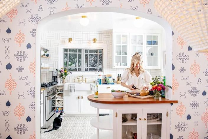 """Arden Myrin's kitchen is complemented by hand-printed wallpaper by Juju Papers. <span class=""""copyright"""">(Mariah Tauger / Los Angeles Times)</span>"""