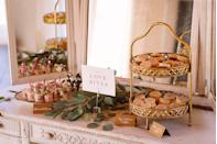 "<p>Infuse your Valentine's Day with a bit of gilded glamour by serving treats on your two-tiered platters. Scatter a few branches of greenery around your treats for added charm. </p><p><em>Via <a href=""https://urldefense.proofpoint.com/v2/url?u=http-3A__www.modernartcatering.com_&d=DwMFaQ&c=B73tqXN8Ec0ocRmZHMCntw&r=1SKxxQCjta-pWEjaI7W4C1a9YhNhSr750SSHCTkjllE&m=PRGBhqdHrcHyqzfAFRuZRSbkhn7aw8x--Ptkbq4qNH4&s=QU8kloeNG6oihAnnEUxfheLb5NaoBUnDJtAw3SnQcMQ&e="" rel=""nofollow noopener"" target=""_blank"" data-ylk=""slk:Modern Art Catering"" class=""link rapid-noclick-resp"">Modern Art Catering</a></em></p><p><a class=""link rapid-noclick-resp"" href=""https://go.redirectingat.com?id=74968X1596630&url=https%3A%2F%2Fwww.etsy.com%2Flisting%2F923631529%2Fdecorative-two-tier-mirrored-gold%3Fga_order%3Dmost_relevant%26ga_search_type%3Dall%26ga_view_type%3Dgallery%26ga_search_query%3Dtwo%2Btiered%2Bgold%2Btray%26ref%3Dsr_gallery-1-17%26frs%3D1&sref=https%3A%2F%2Fwww.elledecor.com%2Flife-culture%2Ffun-at-home%2Fg2387%2Fvalentines-day-decor%2F"" rel=""nofollow noopener"" target=""_blank"" data-ylk=""slk:GET THE LOOK"">GET THE LOOK</a> <em><br>Two Tier Mirrored Gold Serving Tray, Etsy, $42.99</em></p>"
