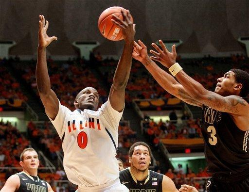 Illinois' Sam McLaurin (0) battles for a rebound against Purdue's Ronnie Johnson (3) during the first half of their NCAA college basketball game, Wednesday, Feb. 13, 2013, in Champaign, Ill. (AP Photo/Darrell Hoemann)
