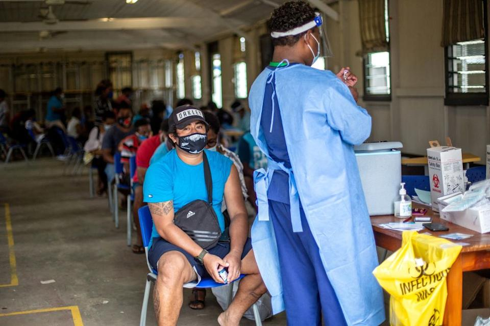 A health worker preparing a dose of AstraZeneca at a vaccination centre in Suva after Fiji announced plans to make the coronavirus vaccine compulsory for all workers as it battles a runaway outbreak of the Delta variant.