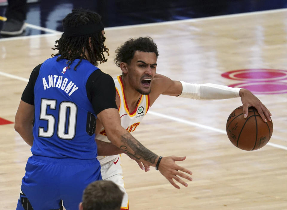 Orlando Magic guard Cole Anthony (50) defends against Atlanta Hawks guard Trae Young (11) in the second half of an NBA basketball game Thursday, May 13, 2021 in Atlanta. (AP Photo/Tami Chappel)