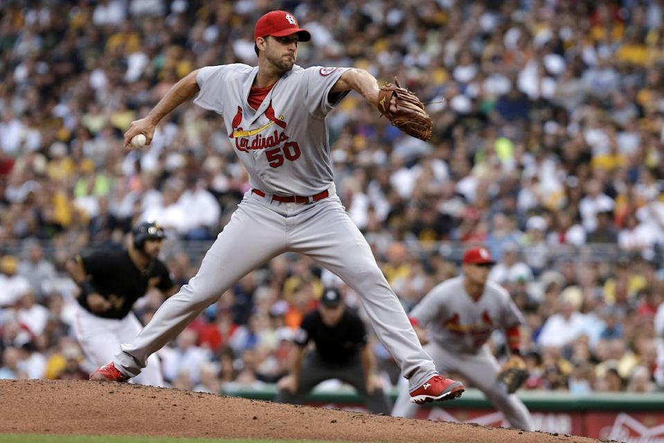 St. Louis Cardinals starting pitcher Adam Wainwright delivers during the first inning of a baseball game against the Pittsburgh Pirates in Pittsburgh on Wednesday, July 31, 2013. (AP Photo/Gene J. Puskar)