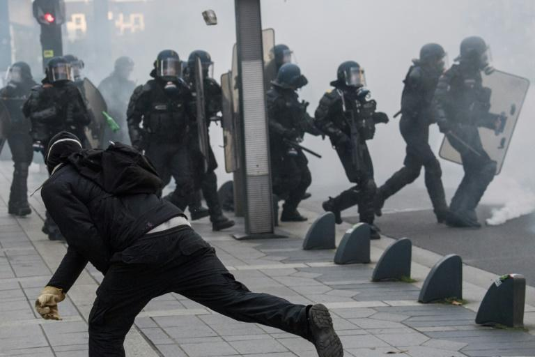 "Riot police officers faced off against demonstrators during a ""yellow vest"" protest in Nantes, western France, on November 16"