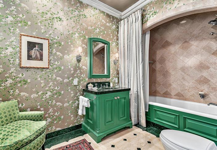 That green sure does pop and we love the floral wallpaper.
