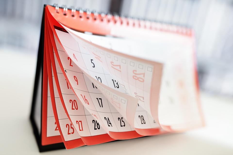 A calendar flipping pages showing months and dates
