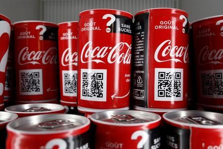 FILE PHOTO: Cans of Coca-Cola are pictured in a refrigerator during an event in Paris